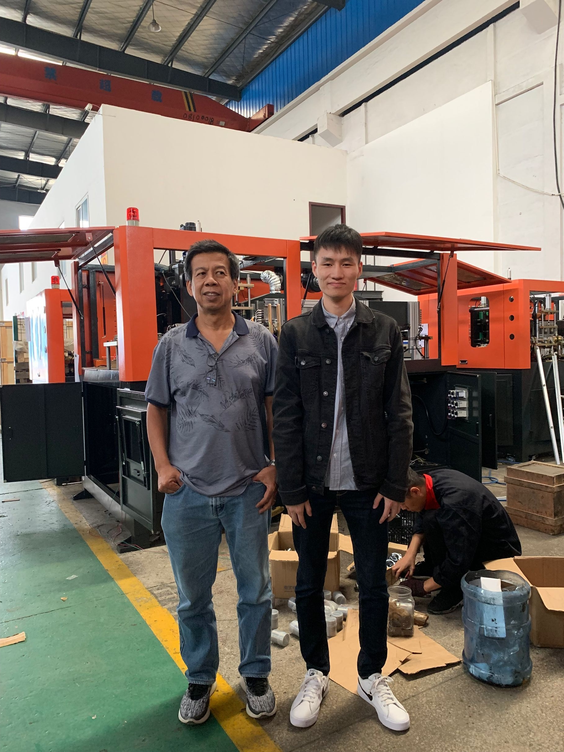 Customer from Thailand visit our factory and purchase a bottle blowing machine